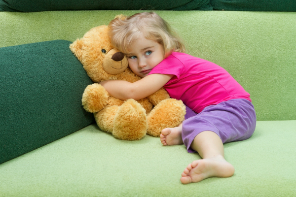 child hugging teddy bear to symbolize child custody