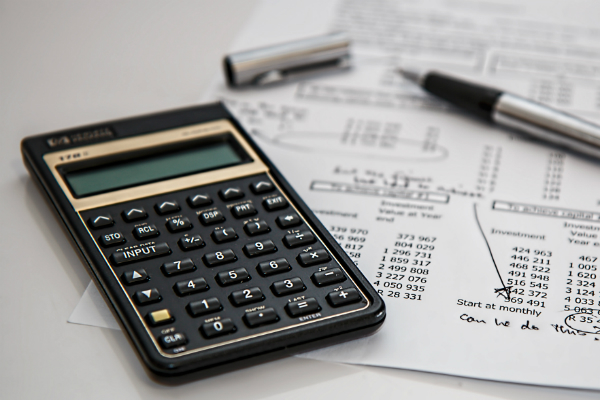 bills and calculator to symbolize repairing finances post-divorce